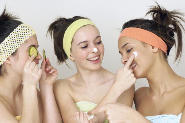 Teenage Girls Applying Face Cream